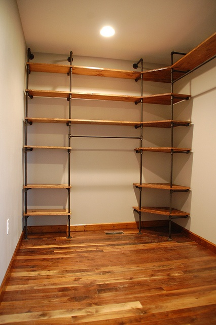 diy-closet-organizer-pipes-pine-shelves