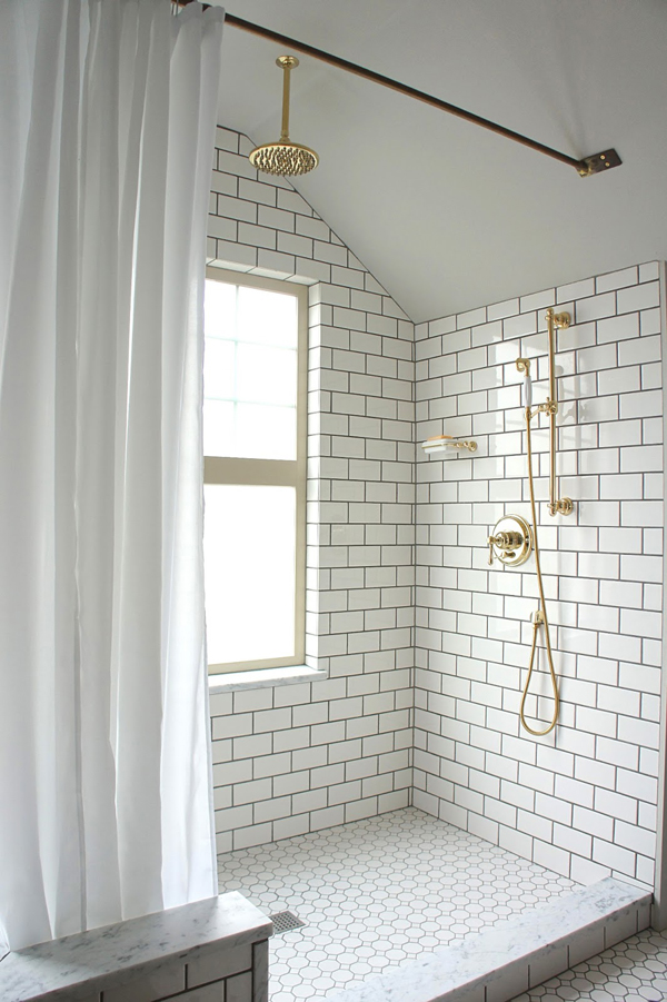 awesome-subway-tile-shower-with-gold-features